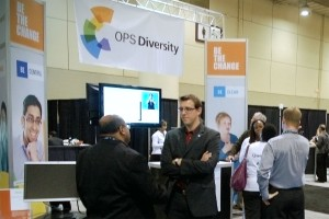 Photo of visitors chatting with staff at the OPS Diversity Booth